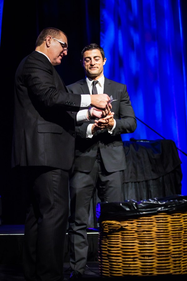 One of Australia's rugby league greats, Anthony Minichiello picking the winning ticket for the Lexus Canberra car raffle