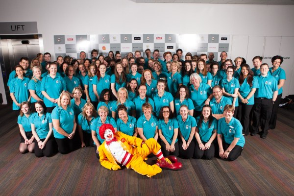 Volunteers at the Ronald McDonald house charity gala ball with Ronald McDonald himself
