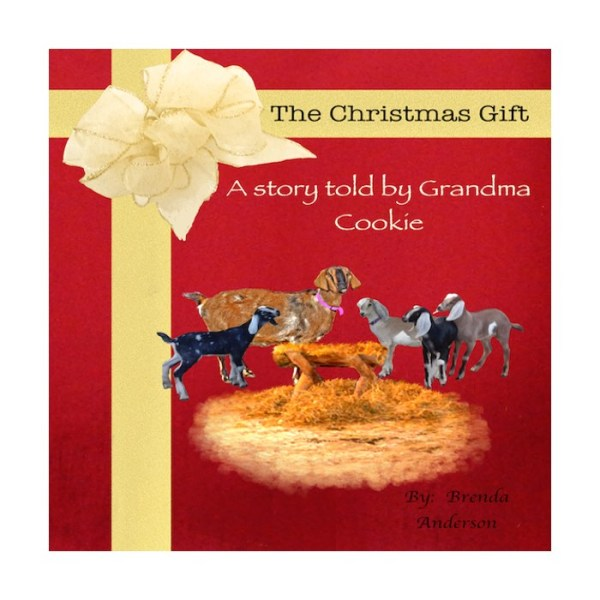 The Christmas Gift a red book with a bow goats on the front cover with a manger