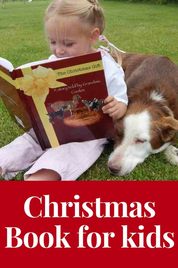 The Christmas Gift book with a little girl reading to her dog