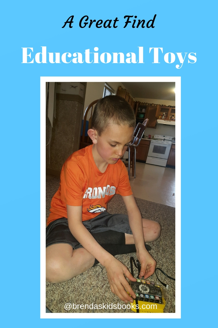 STEM toys, boy working on an educational robot toy