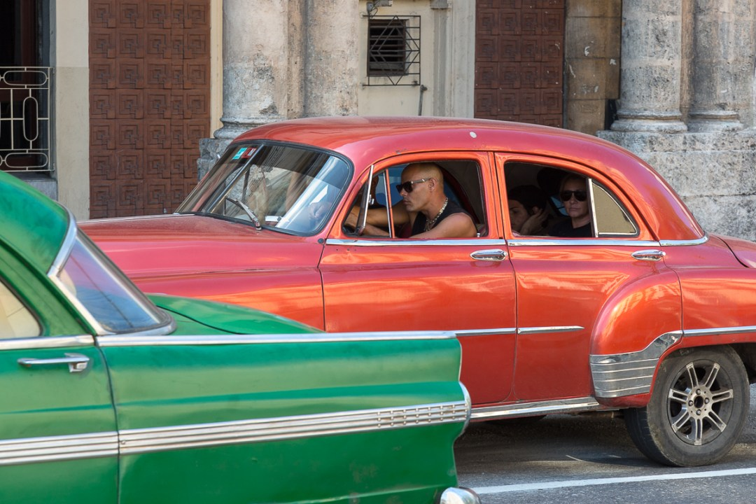 Red and Green classic cars, Havana, Cuba.