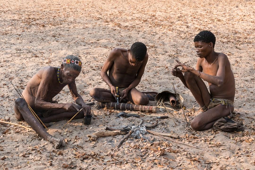 Bushmen making arrow, Namibia, Africa.