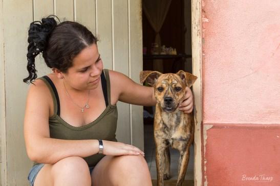 Girl and pet dog, Trinidad, Cuba.