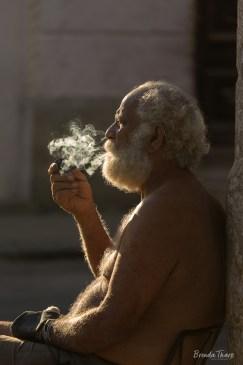 A man smoking a pipe.