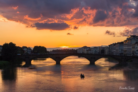 Sunset over the Arno river.