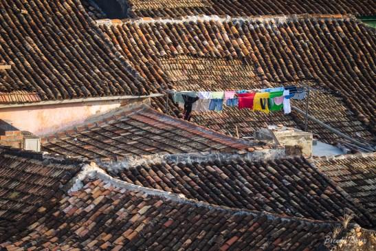 Laundry hangs amidst tile rooftops, Trinidad, Cuba.