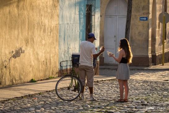 Woman buys food from street vendor, Trinidad, Cuba.