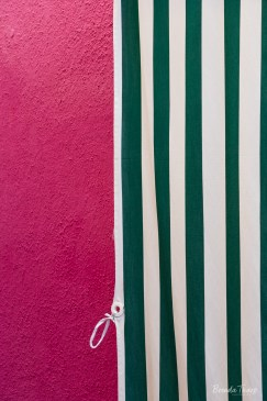 Striped Curtain against pink wall, Burano.