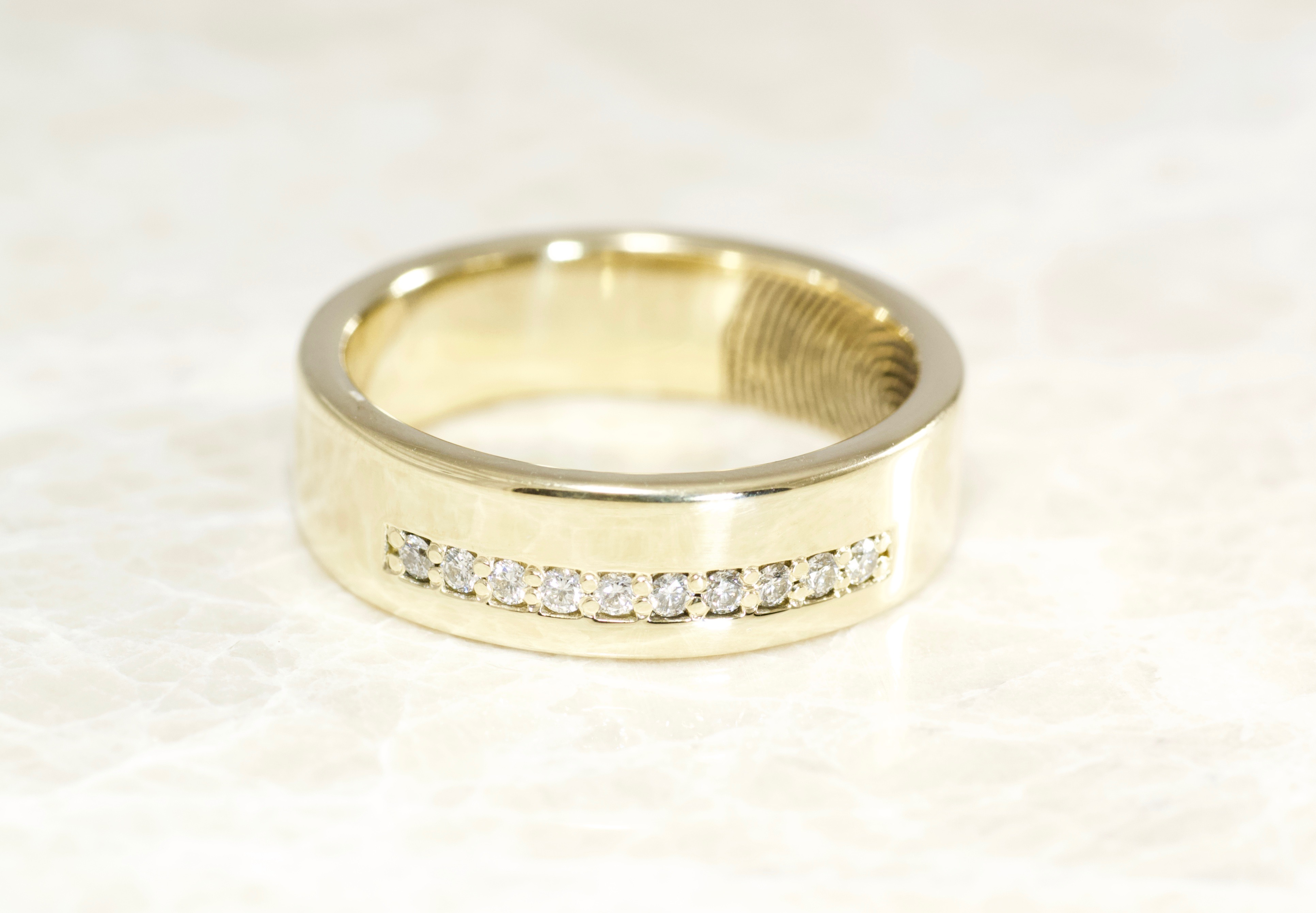 Custom diamonds and 14k yellow gold fingerprint ring by Brent&Jess