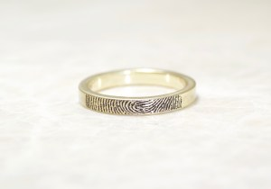14k yellow gold band with your fingerprint on the outside