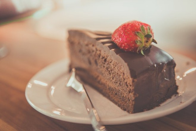Piece of chocolate cake with a strawberry on top
