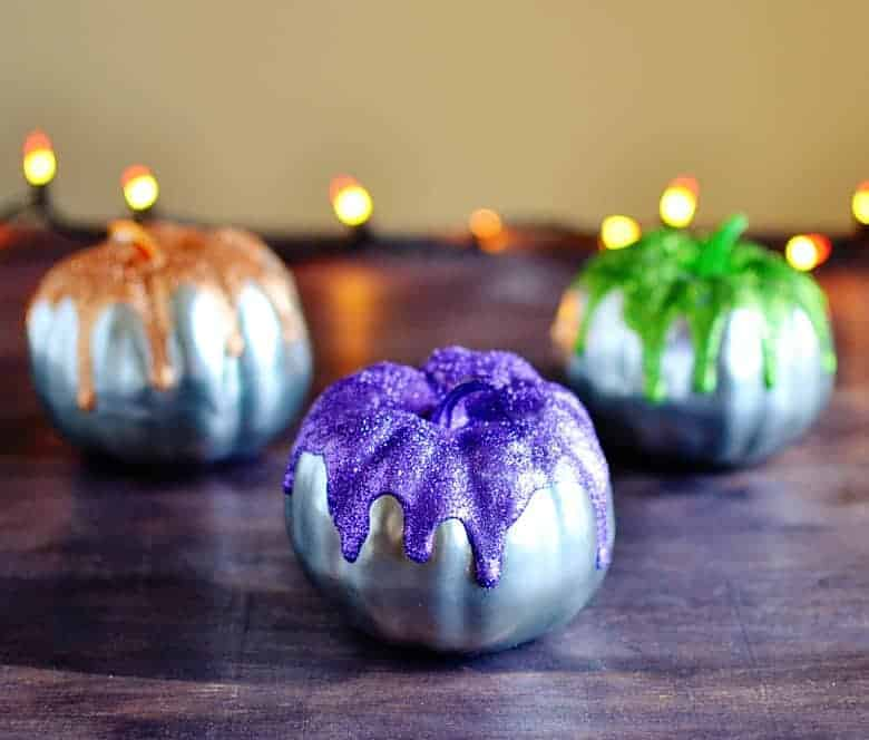 This is the perfect budget Halloween decor project. Love these cute glitter frosted mini pumpkins!