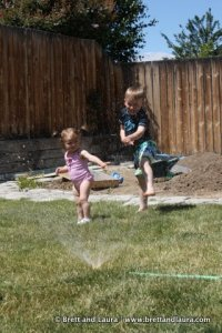 Ethan and Autumn in the sprinklers
