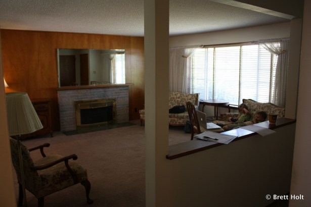 Family Room. Carpet is being pulled and wood floors underneath refinished by us.