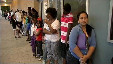 Newark parents and students wait in long lines to find out their school assignment. Next, they stand in line at another location to actually enroll. Credit: myfoxtampabay.com
