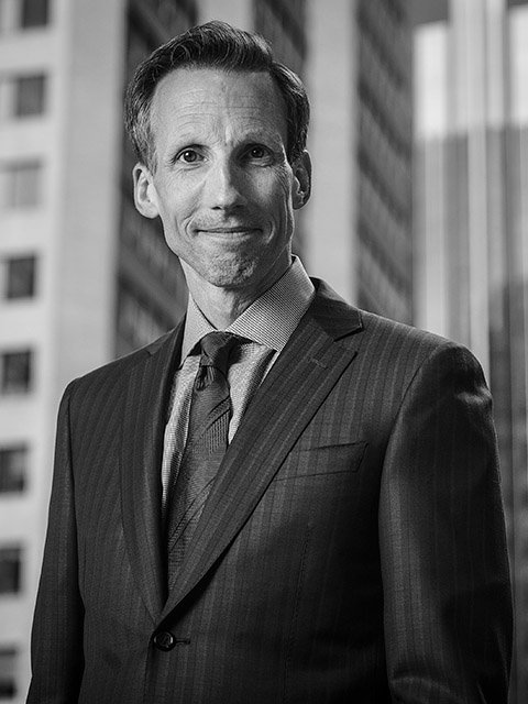 Black and white business portrait of lawyer Crispin Arthur of Lawson Lundell law firm by Calgary photographers Gilmour Photography.