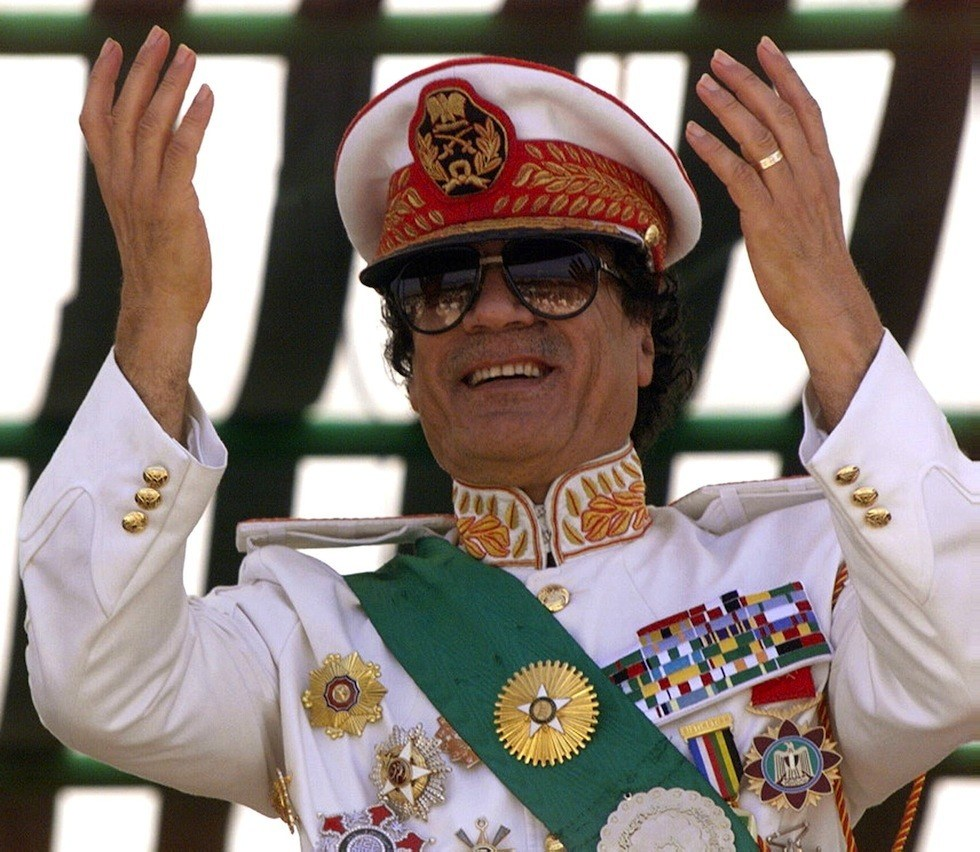 Libyan leader Moamer Kadhafi salutes his troops pa