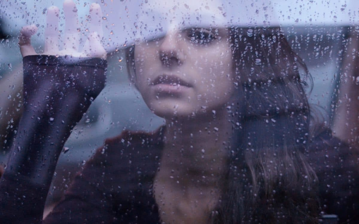 cute-girl-rain-window-background