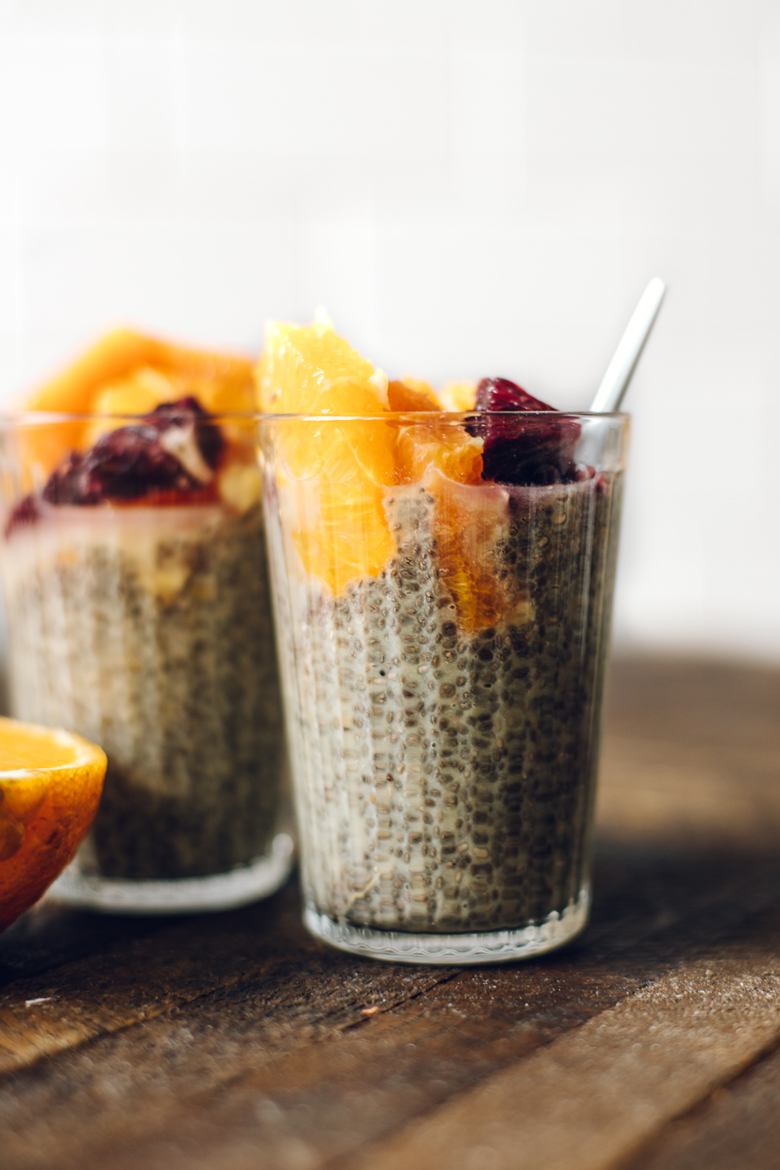 two cups of orange creamsicle chia seed pudding topped with orange slices