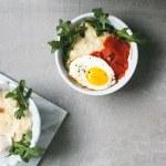 smoked salmon, grits, arugula, eggs bowl