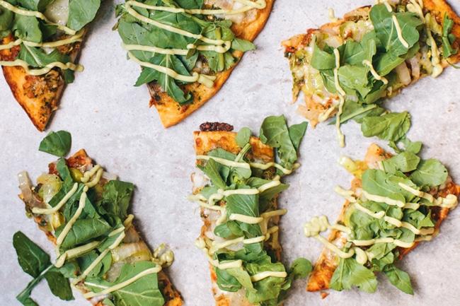 green goddess pizza with creamy avocado mint dressing