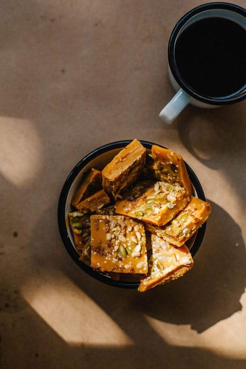 A bowl full of hormone balancing pumpkin bark in dappled sunlight