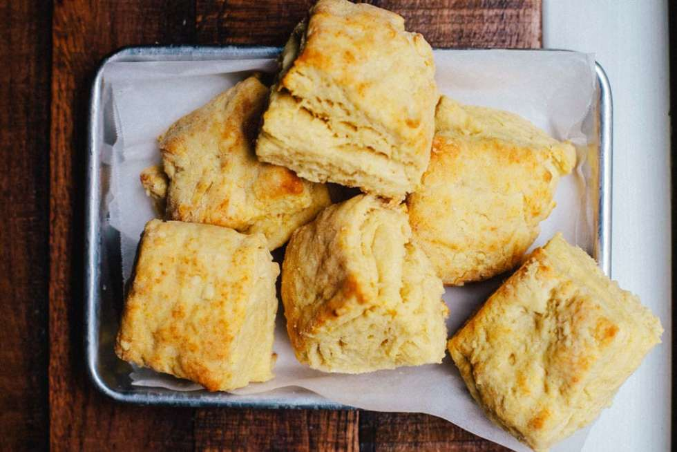 A tray of six golden, fluffy, flaky, buttermilk biscuits made with ghee