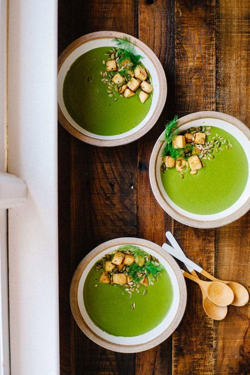 Three bowls of greens soup
