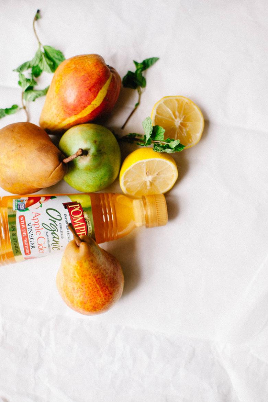 apple cider vinegar surrounded by fruit