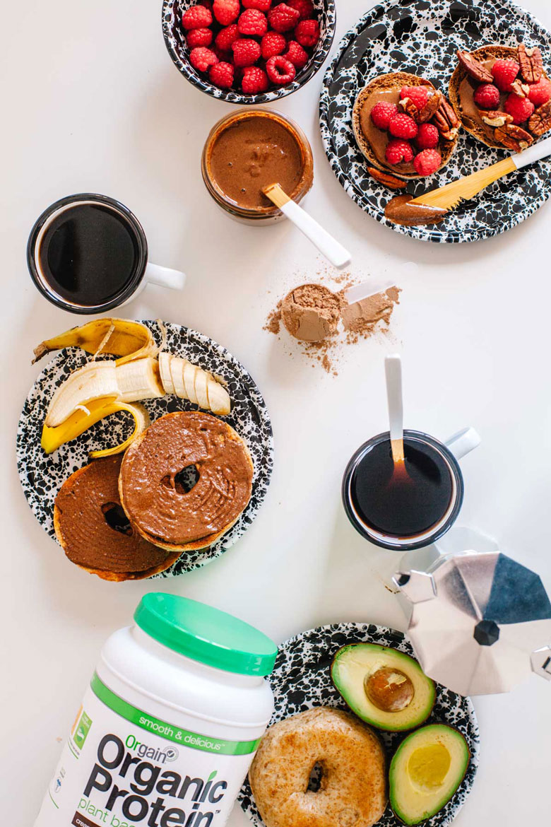 chocolate pecan protein spread breakfast with bagels, fruit, and coffee
