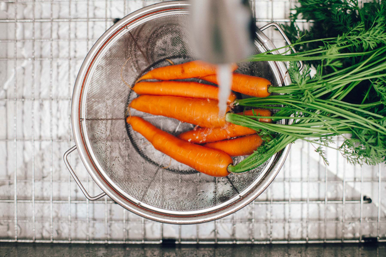 carrots being washed