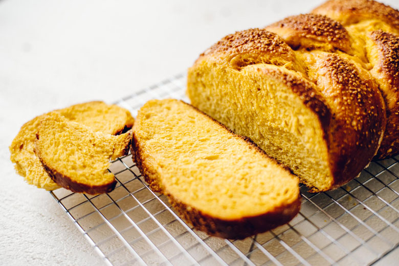 a sliced loaf of Maple Pumpkin Challah