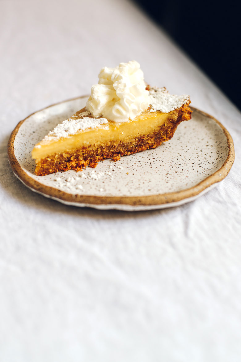 single slice of healthyish crack pie with whipped cream
