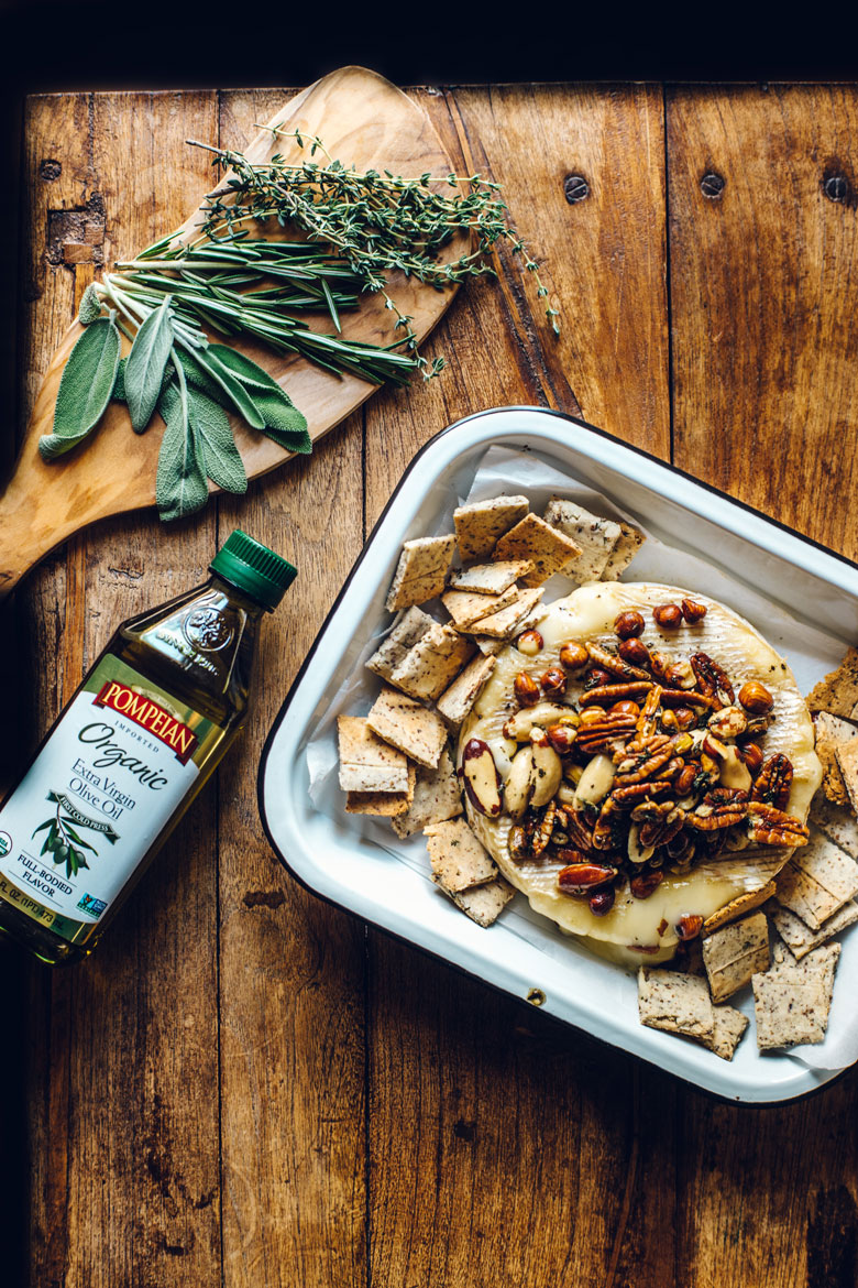 keto baked brie with nuts, herbs, and Pompeian Olive Oil