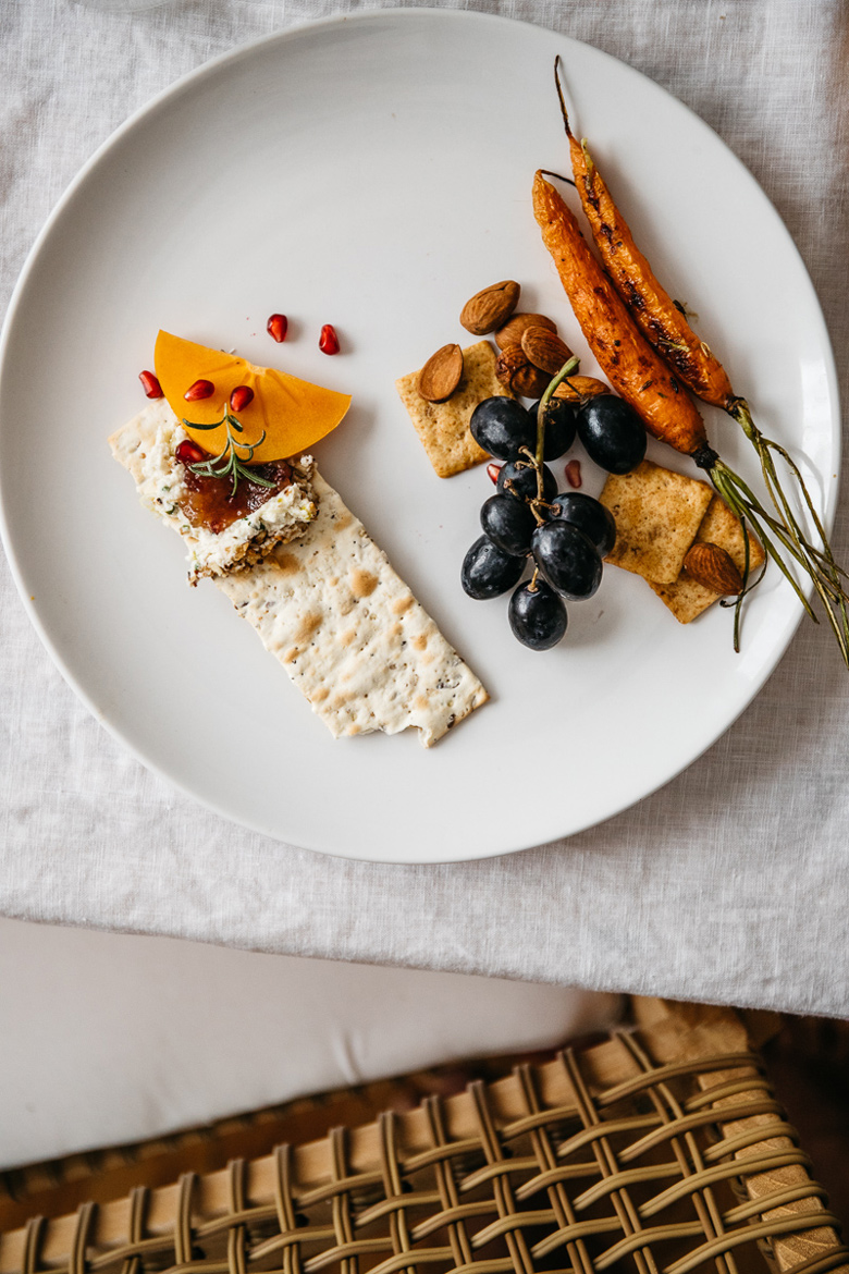 thanksgiving plate with crackers, nut cheese, fig jam and fruit