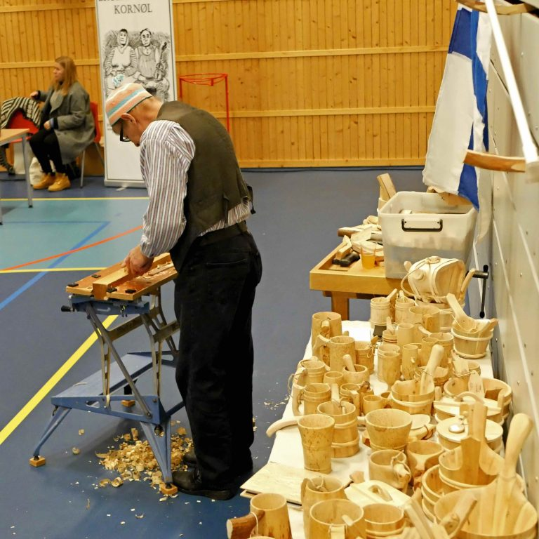 Risto Telkkä selling traditional wooden drinking vessels, such as haarikka
