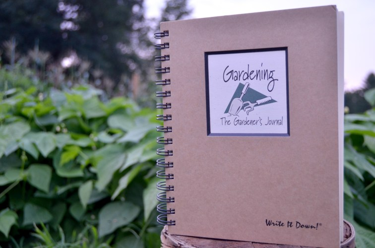 Gardening Journal: A Journal sitting on a basket with green beans in the background.