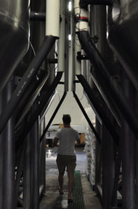 A corridor of crowed tanks at the Stone & Wood Byron Bay brewery