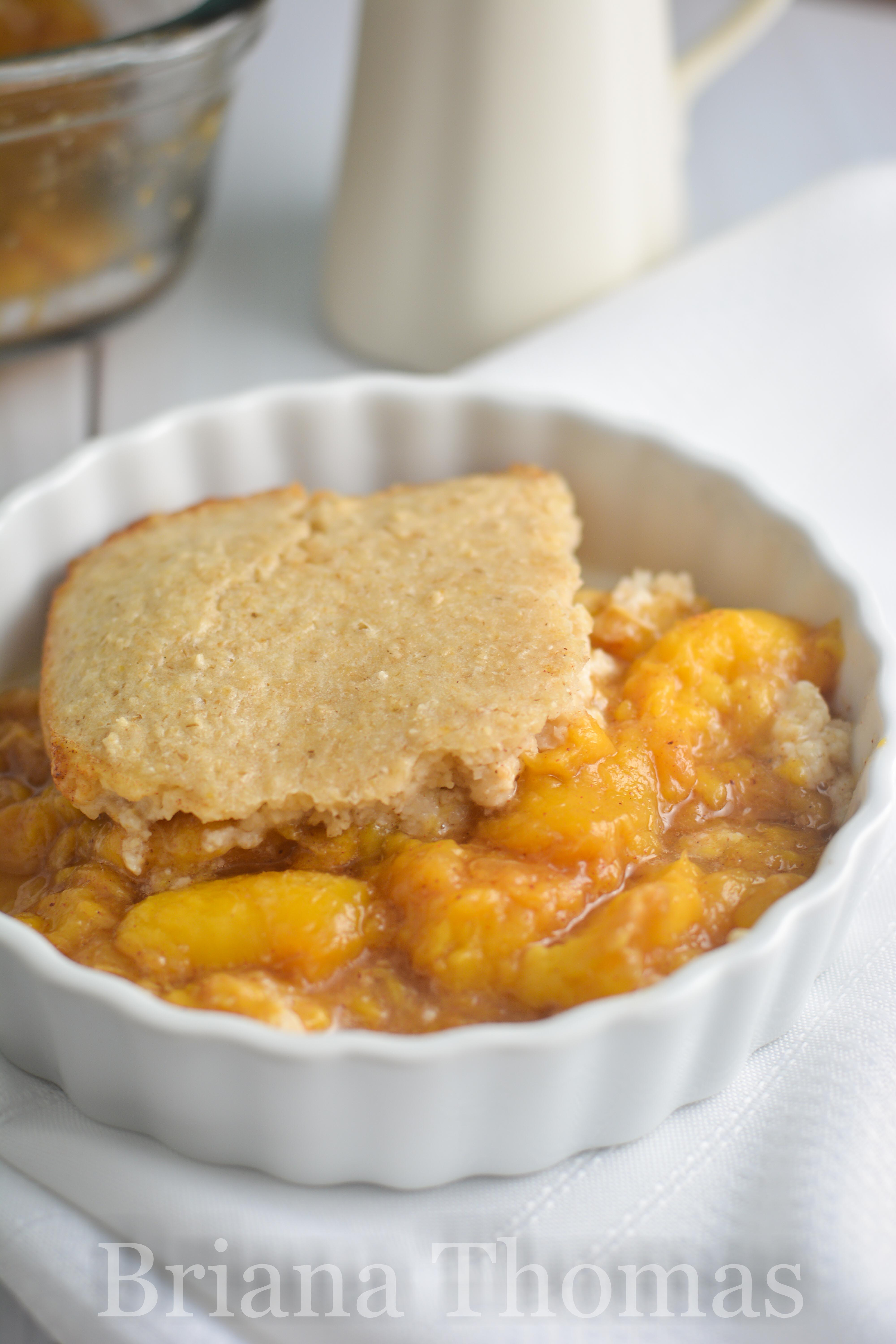 This peach cobbler with biscuit topping is a yummy THM:E dessert! No added sugar, low fat, gluten/nut free - and no special ingredients required!