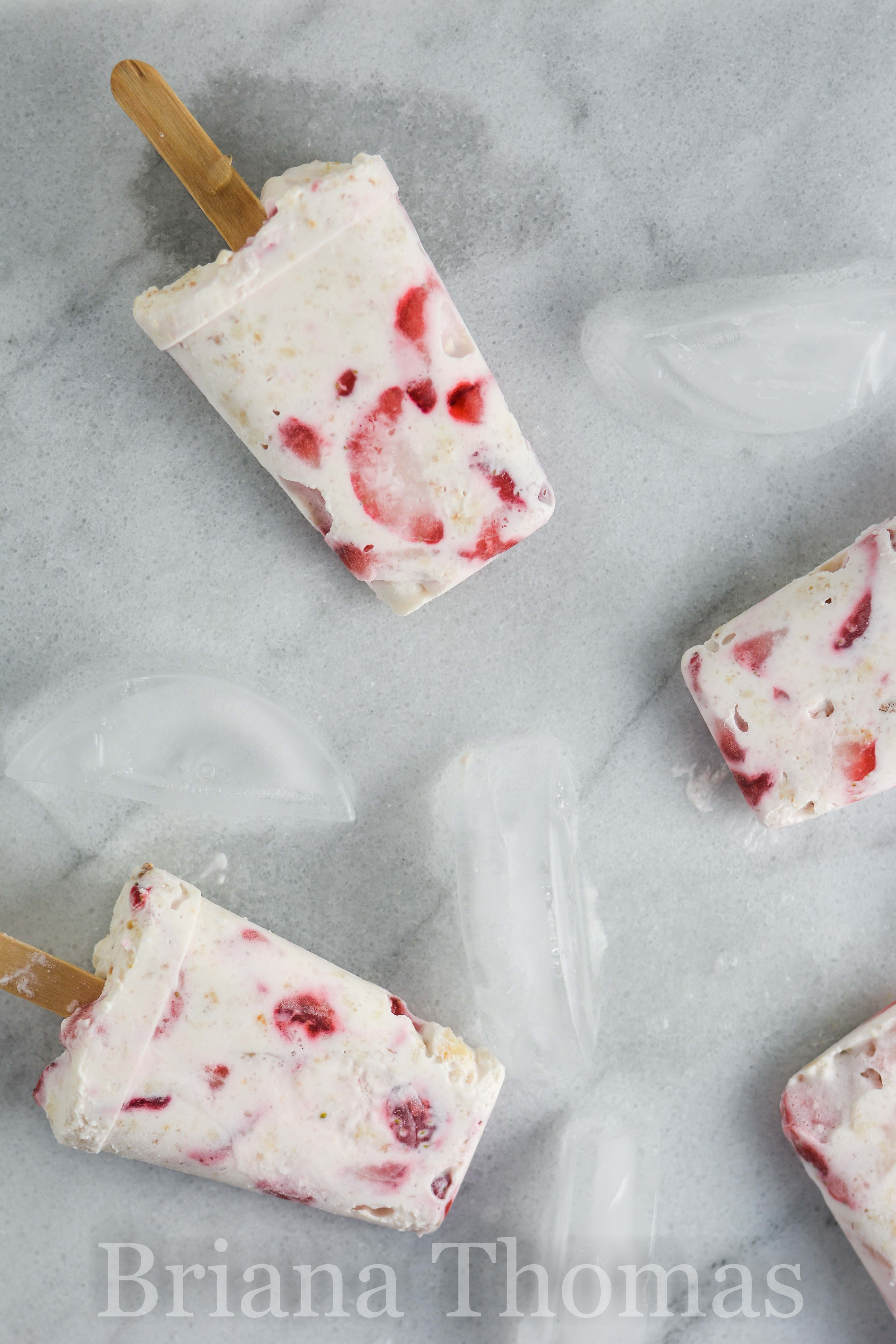 These low-carb Strawberry Delight Popsicles are no-bake cheesecake delight in popsicle form! THM:S, sugar free, gluten/egg/nut free, low glycemic