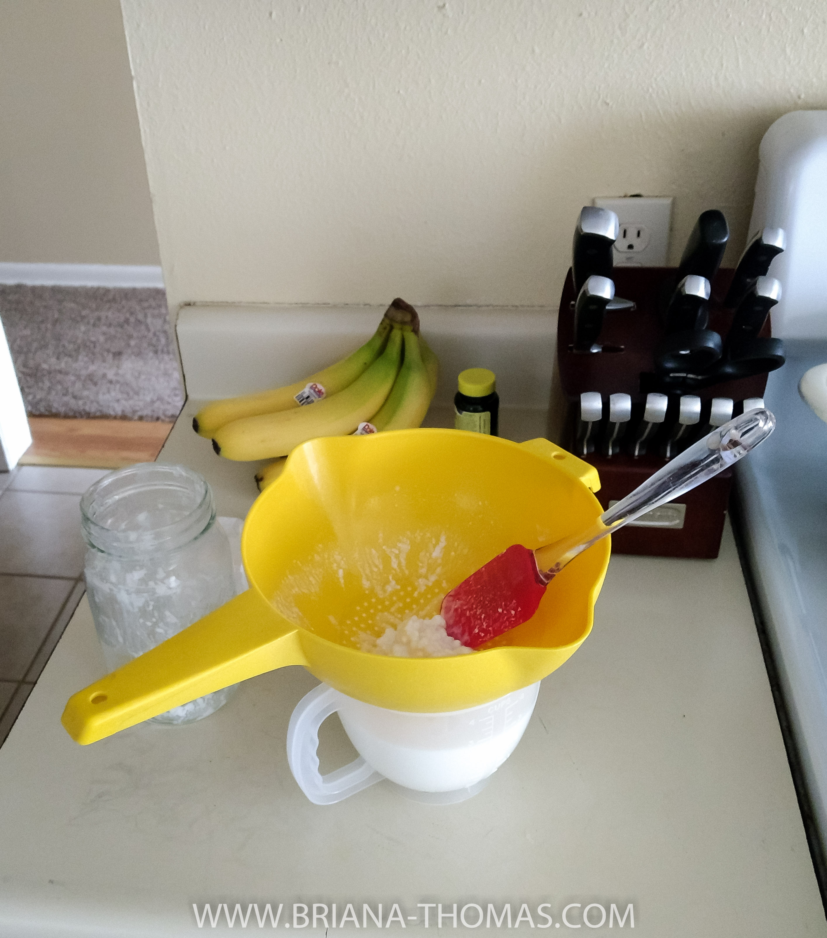 Straining my kefir with my new colander!