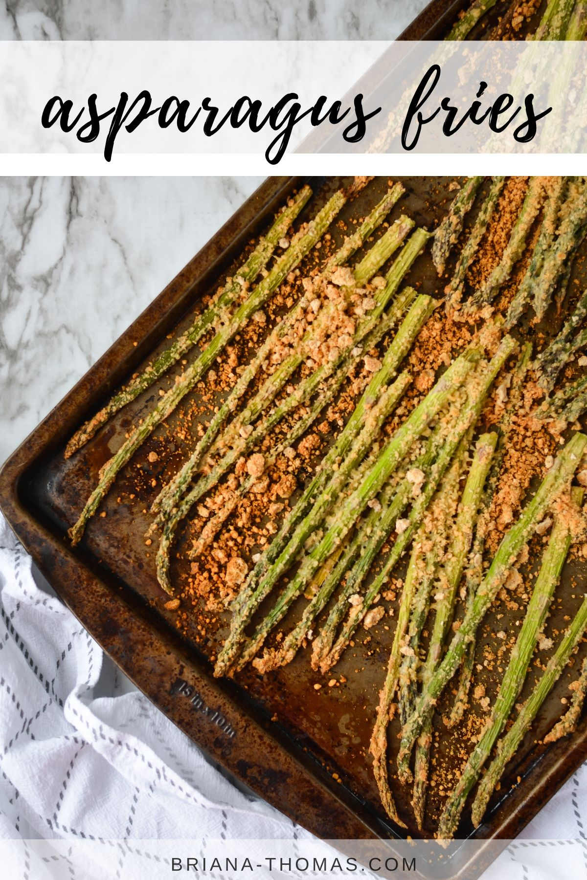 baked asparagus spears coated in crumb mixture on sheet pan