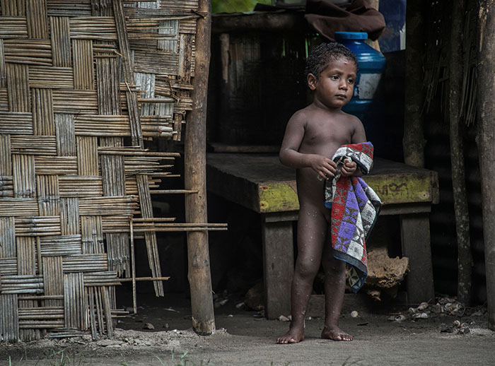 A young child on Hawaii Island, Manus Province PNG - by Brian Cassey