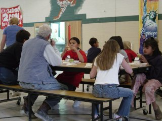 Bendel eating lunch with some of the kids