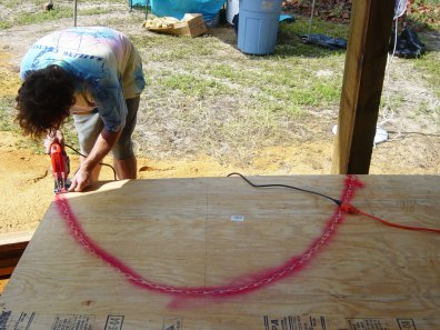 cutting the arch form out of plywood