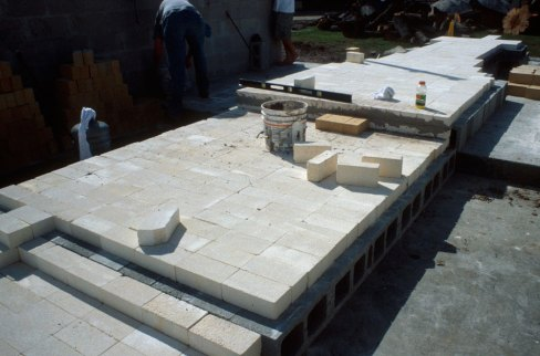 laying insulation brick over foundation