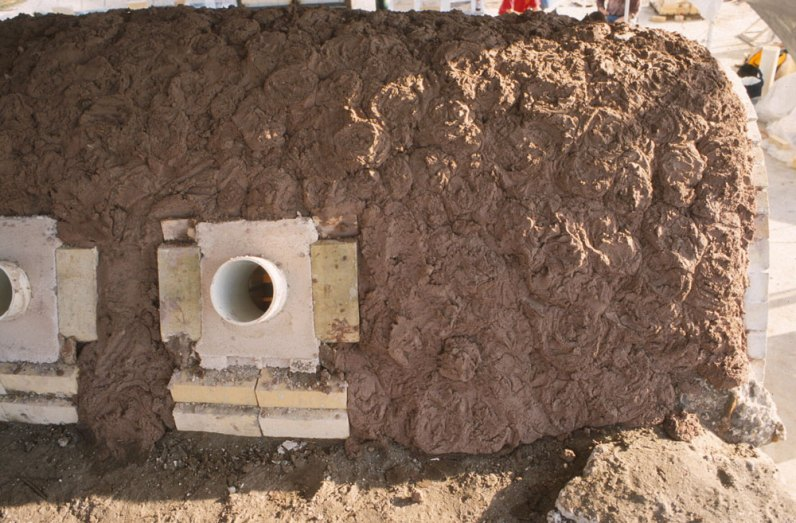 adding a thick layer of clay insulation over kiln