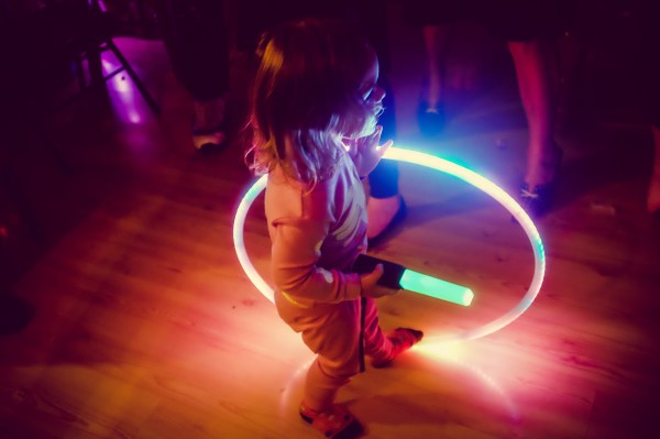 child with led hula hoop