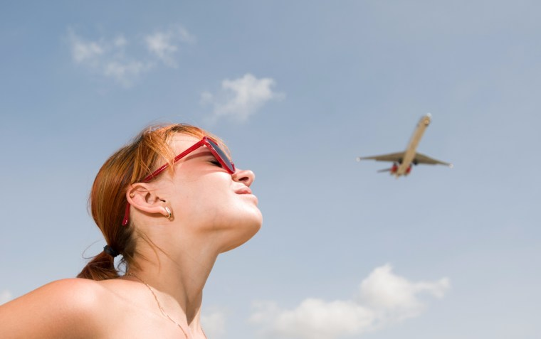 Woman watching a plane depart